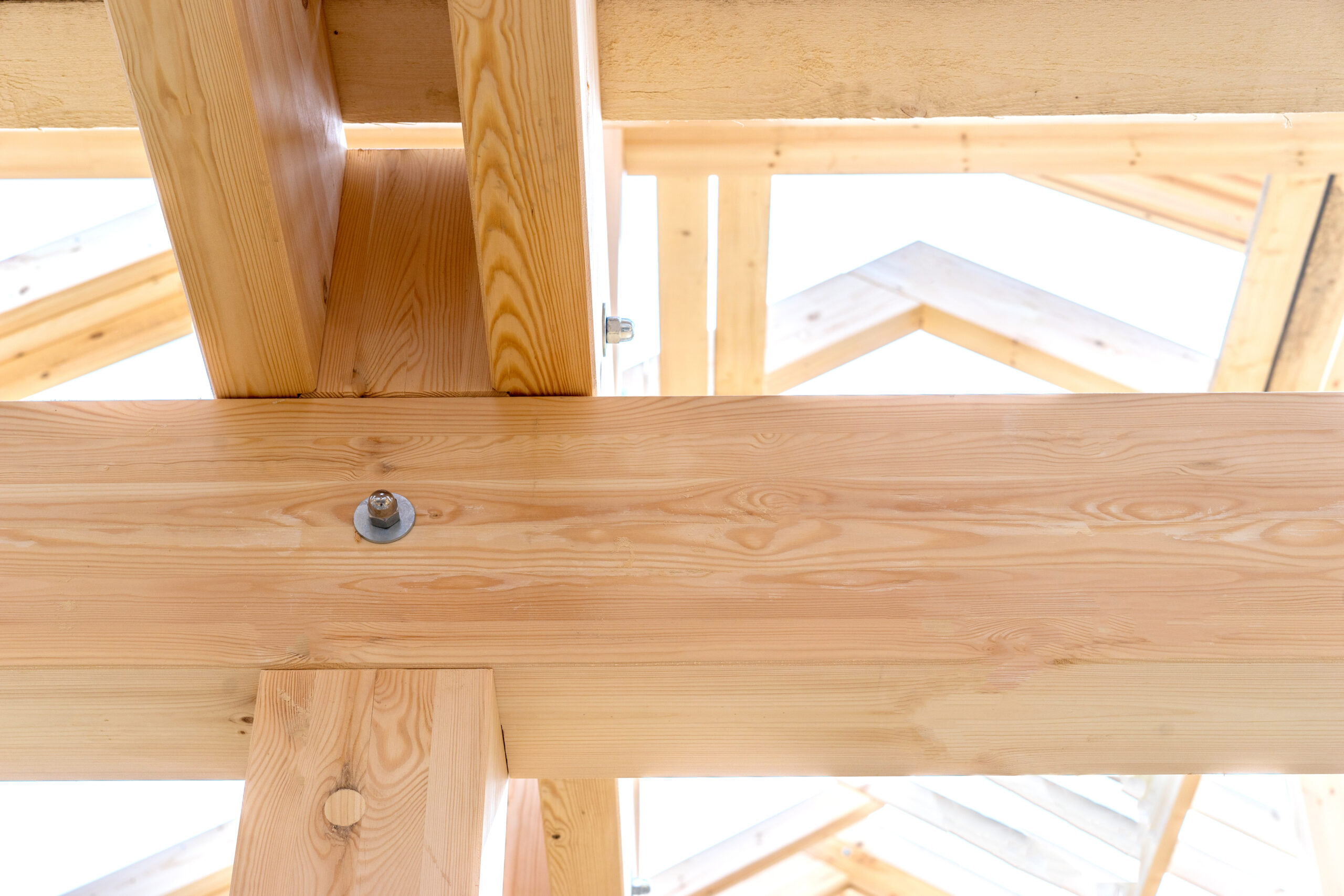 Fragment of a wooden house. Fastening of beams of a building. Fragment of building a house. Connections of wooden structures. Building concept.